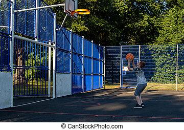 Pre-teen caucasian boy playing outside