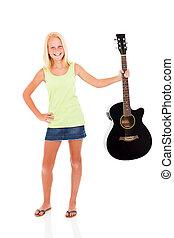 pre teen girl showing her guitar