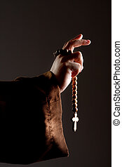Preaching medieval monk hand with wooden rosary