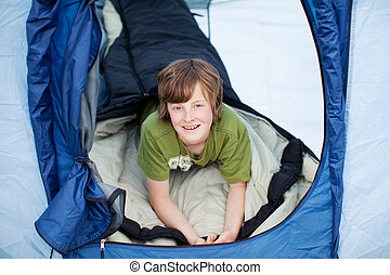Preadolescent Boy Lying In Tent