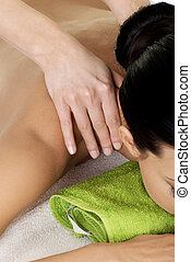 Preaty young woman relaxing beeing massaged