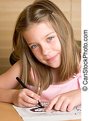 Precious Angel - A beautiful little girl coloring a picture...