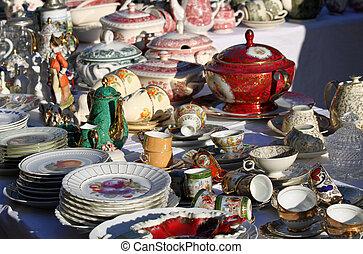 precious antique furnishings and retro ceramic plates