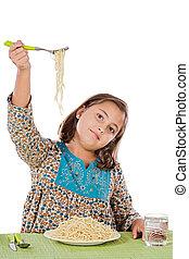 Precious girl eating spaghetti