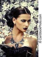 precious necklace - Beautiful brunette woman in long black...