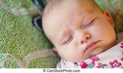 precious newborn baby is laying on a comfortable bed, sleeping peacefully