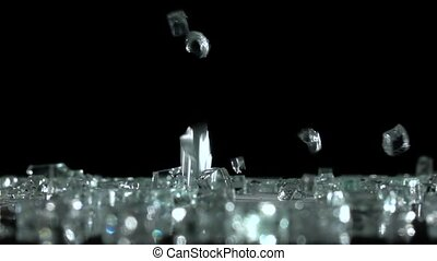 Precious stones falling on the floor in a dark room. Black background . Slow motion