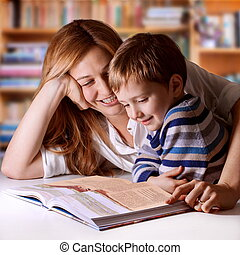 Precious time - Mother reading Bible stories to her boy