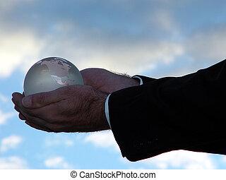 Precious World - Man holding world globe with his his hand...
