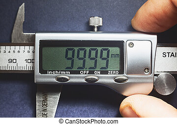 Precise - Details of modern measuring tool, digital display ...