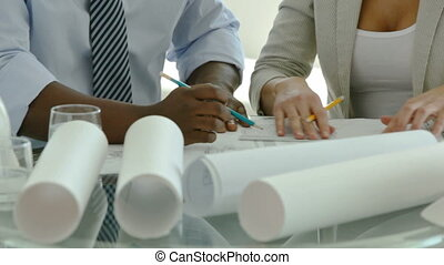 Precision work - Dolly shot of business people drawing...