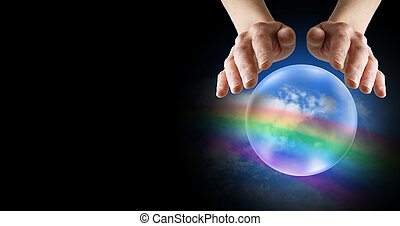 Clairvoyant hands over crystal ball with rainbow and blue sky on a black website banner background