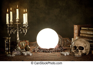 Halloween scene of a crystal ball, skull and candles