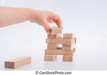 predios, blocos madeira, tocando, mão