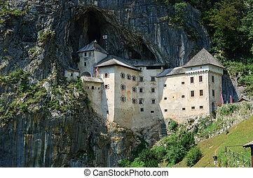Predjama Castle in Postojna, Slovenia. Vertical view
