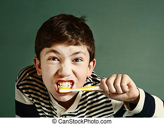 preen boy brush teeth close up portrait