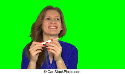 happy smiling woman looking at pregnancy test
