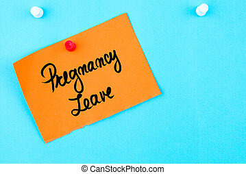 leave out pay written on orange paper note pinned on stock  pregnancy leave written on orange paper note