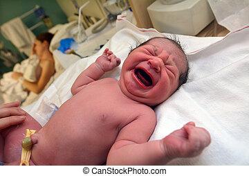 Pregnancy - Newborn baby - AUCKLAND - JUNE 07 2014:Newborn ...