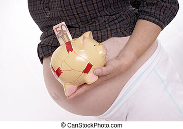 pregnancy - pregnant woman with a piggy bank