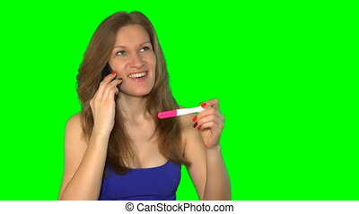 Pregnancy test - happy woman on phone, positive result...