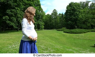 Pregnancy time lifestyle in park meadow. - Pregnancy time...