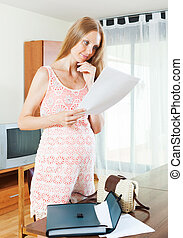 pregnancy woman with paper document