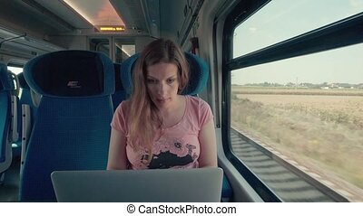 Pregnancy Woman Working with Laptop on a Train
