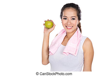 pregnant asian woman holding an apple, smiling to the camera