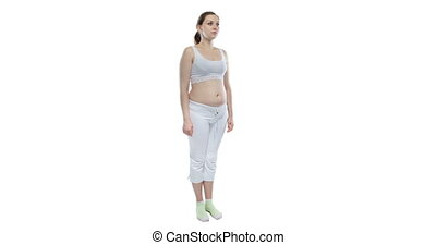Pregnant caucasian girl with bare belly