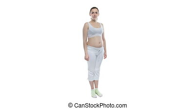 Pregnant caucasian woman with bare belly