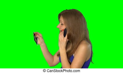 pregnant cheerful woman holding ultrasound scans and talking...