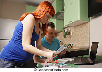Pregnant couple doing paperwork