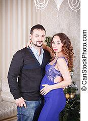 Pregnant couple embrace