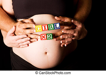 Pregnant couple holding wooden playing blocks - Pregnant...