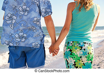 Pregnant couple in love on the beach