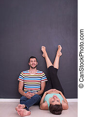 pregnant couple relaxing on the floor