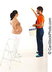 Pregnant couple renovate room