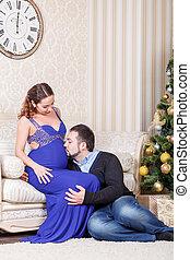 Pregnant couple sitting