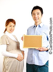 pregnant couple with massage board