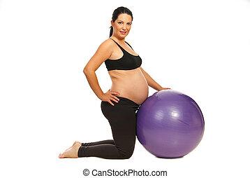 Pregnant doing exercises