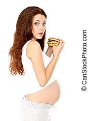 Pregnant eats sandwich