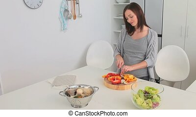 Pregnant female cooking in the kitchen