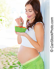 Pregnant female eat fresh tasty fruits, young mother awaiting baby, healthy eating concept, new life