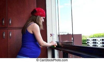 Pregnant female girl clean dust in flat house loggia Static...