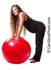 Pregnant fitness woman doing exercise on fitball on white background The concept of Sport and Health