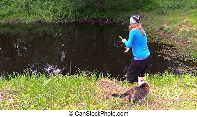 pregnant girl fish cat - Pregnant woman girl catch fish with...
