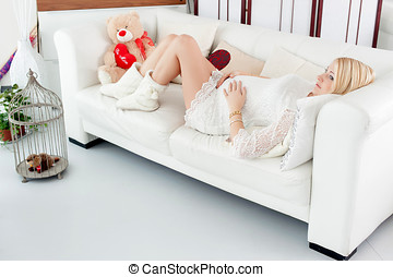 pregnant girl hugging a teddy bear