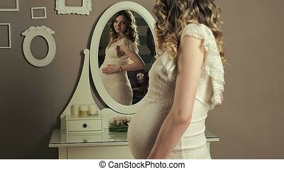 pregnant girl in front of mirror