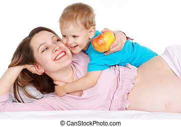 Pregnant girl plays with a baby